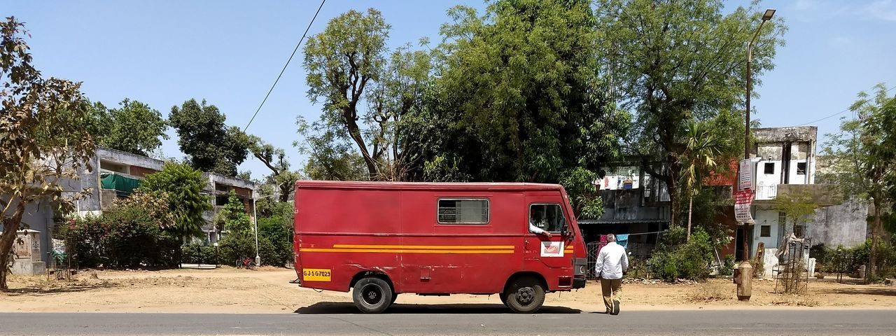 Speed Post is The Best shipping service in India Mail Services Post Van Indiapost Speedpost Tree Land Vehicle Red Sky Vehicle