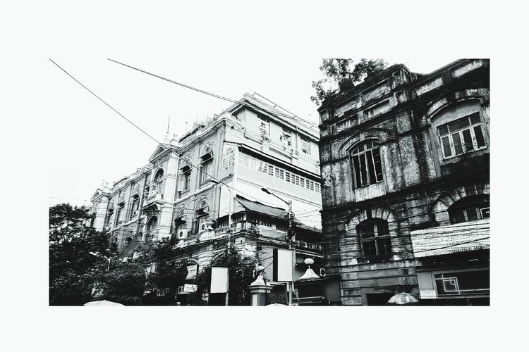 Calcutta kiss Architecture Building Exterior Built Structure Low Angle View Window Day Outdoors City Life Apartment Building Story High Section Street Architecture Kolkatadiaries KolkataStreets Colonial Cities Travel Destinations Famous Place Memories Architectural Feature Building Balcony Cloud - Sky
