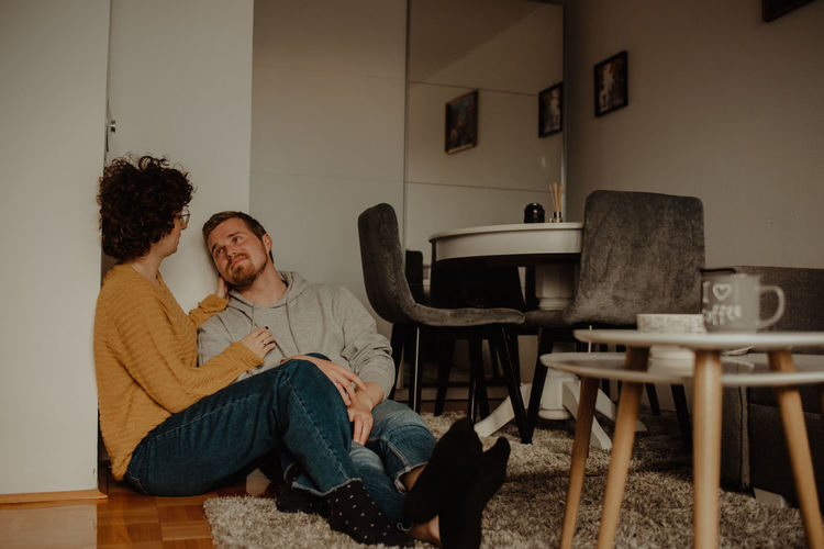 People sitting on chair at home