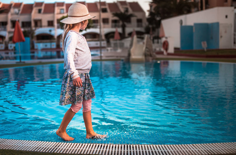 Full Length Of Child At Swimming Pool