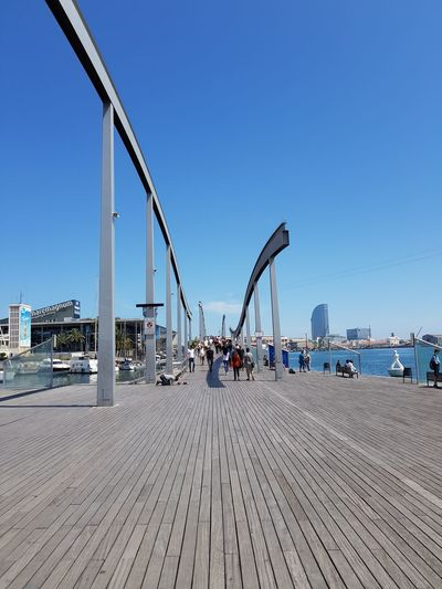Panoramic view of bridge against clear blue sky