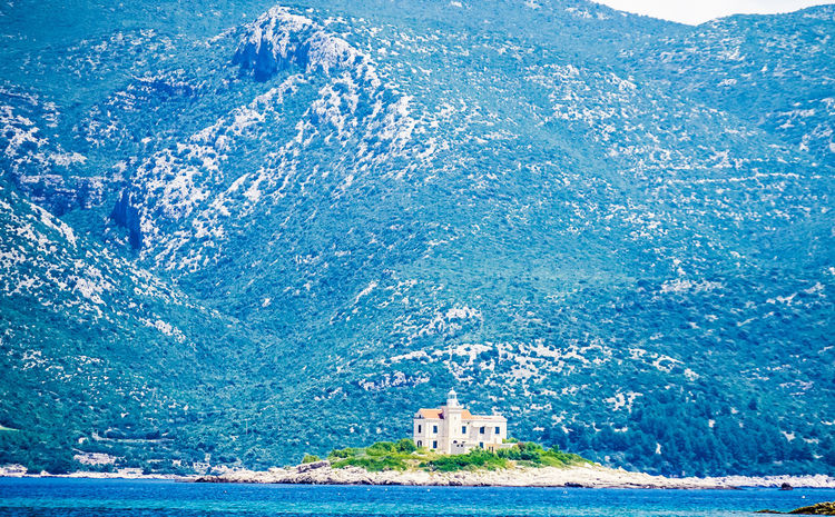 Lighthouse near Korcula Architecture Blue Croatia Day Korčula Landscape Landscape Photography Landscape_Collection Lighthouse Mountain Range Mountains Nature No People Orebic Outdoors Sea Sky Travel Destinations Tree Water Wave