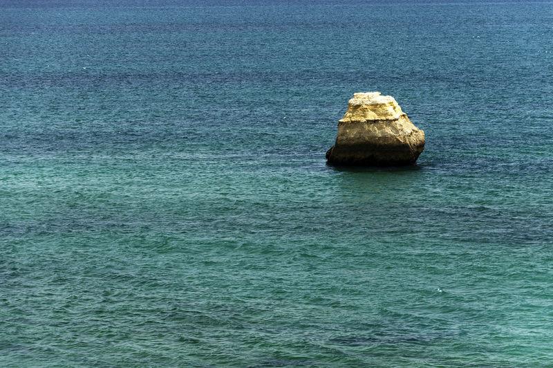 Scenic shot of headland in calm blue sea