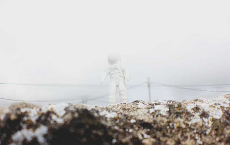Surface level of astronaut toy on rock