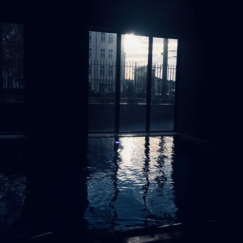 Dark Indoor Pool Pool Swimming Pool Swimming Architecture Water Built Structure Building Exterior Building Nature No People Silhouette Waterfront Wet City