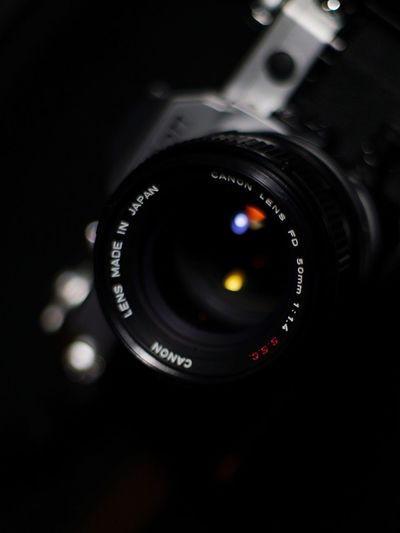 Camera - Photographic Equipment Photography Themes Lens - Optical Instrument Digital Camera Photographic Equipment Technology SLR Camera Digital Single-lens Reflex Camera Close-up Modern Camera No People Black Color Photographing Illuminated Black Background Camera Flash Indoors