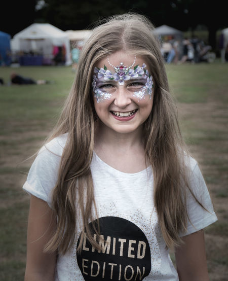 Portrait of smiling girl with face paint