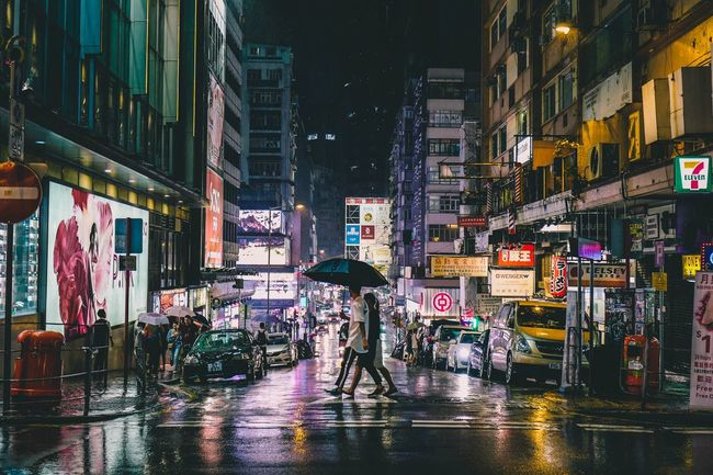 Rain Night Nightshooters Discoverhongkong Street Photography Reframinghk City Building Exterior Architecture Street Night Built Structure Illuminated Wet Real People Men City Street Umbrella Group Of People Rainy Season Bicycle Mode Of Transportation Outdoors City Life Transportation Rain