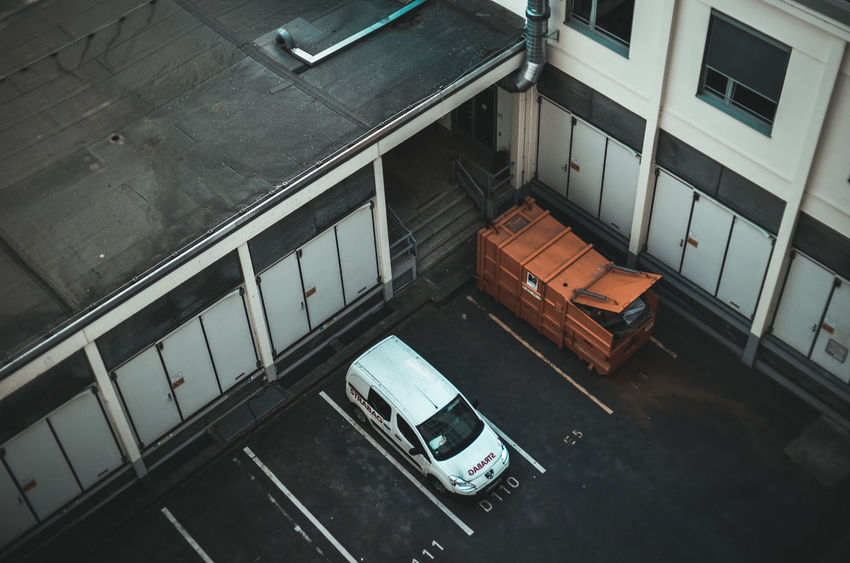 Carrier Air Pollution Alone Architecture Backyard Building Exterior Built Structure Cargo Carrier City Danger Dirty Globalization Growing City High Angle View Human Traffic Moody No People Parking Scary Shipping  Sketchy Trade Transportation Urban Vehicle