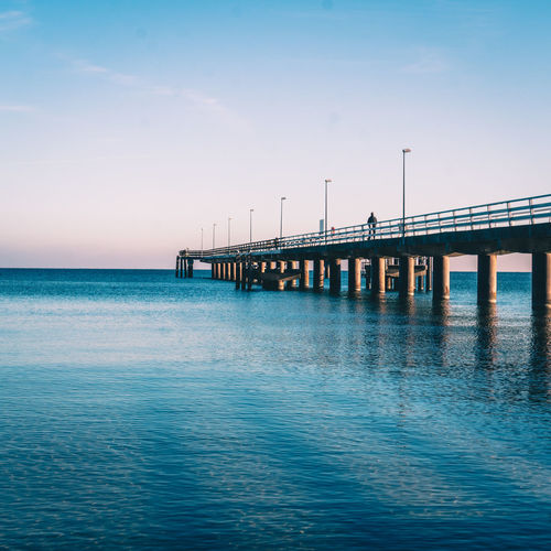 Waterfeeling Germany🇩🇪 Bluesky Nature_perfection Impression Ausflugsziel Outdoor Photography Meerblick Ostseestrand Photographylovers Beautiful Blue Sky Water Sea Beach Clear Sky Wooden Post Blue Bridge - Man Made Structure Sunset Business Finance And Industry Horizon Seascape