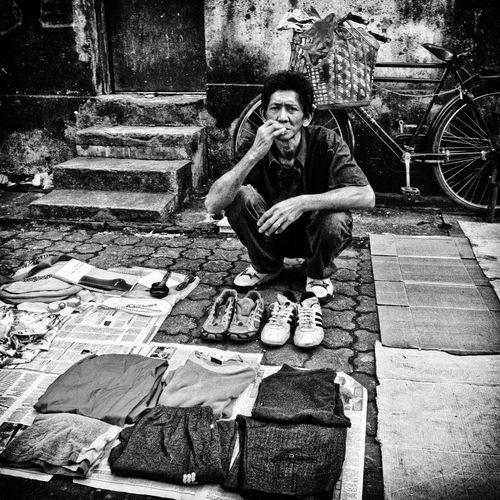 Street Peddler at Petaling Street Flea Market, Kuala Lumpur B&w Street Photography Candid Photography Candid Shot Flea Markets Monochrome Petaling Street Real People Street Peddler Street Photography First Eyeem Photo People People Watching