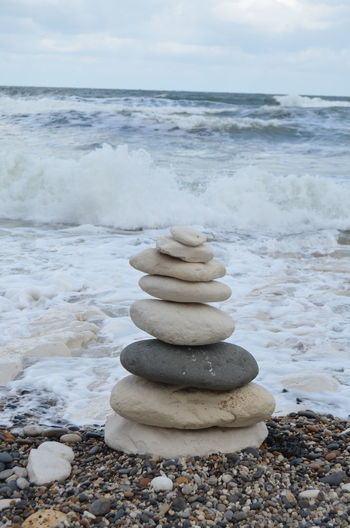 Rock Solid Pebble Stone - Object Stack Sea Stone Beach Land Balance Rock - Object Zen-like Beauty In Nature Water Sky Nature Scenics - Nature Horizon Over Water Tranquility No People Outdoors