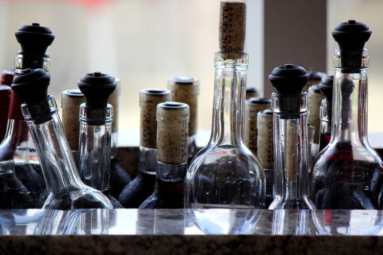 Glass Bottles Against Window