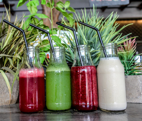 Low angle view of juices in bottle on table
