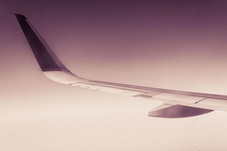 Airplane against clear sky