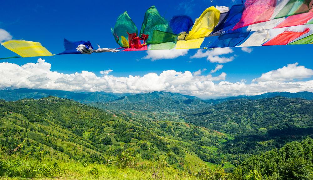 Gebetsfahnen in Kathmandu ASIA Kathmandu Nepal Beauty In Nature Blue Cloud - Sky Day Flag Flying Hanging Katmandu Mountain Mountain Range Multi Colored Nature No People Outdoors Scenics Sky Tree