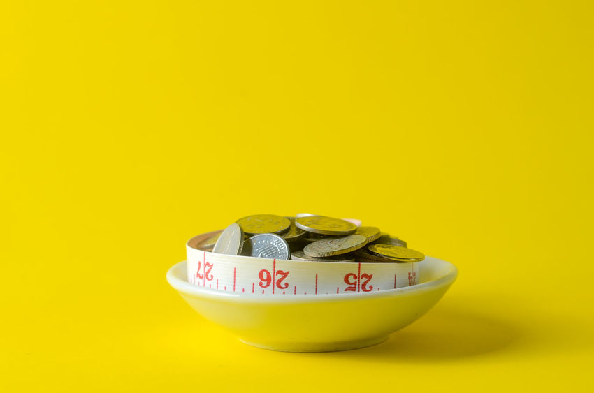 Business Close-up Coin Colored Background Copy Space Currency Cut Out Finance Food Food And Drink Indoors  Large Group Of Objects No People Still Life Studio Shot Text Wealth Western Script Yellow Yellow Background