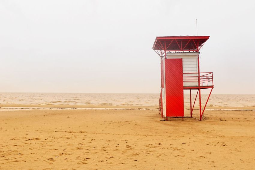EyeEm Selects Beach Sand Lifeguard Hut Sea Lifeguard  Water Tranquility Tranquil Scene Horizon Over Water Day Scenics Nature Clear Sky No People Outdoors Sky Beauty In Nature Baltic States Baltic Sea Winter The Week On EyeEm Eye4photography  Estonia Red