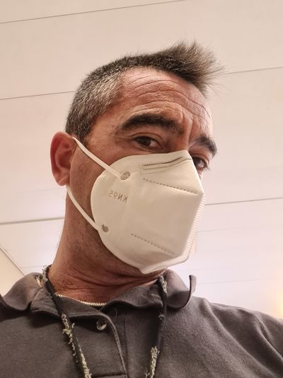 Low angle portrait of man wearing mask
