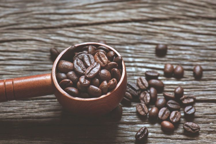 Coffee beans Roasted Coffee Bean Food And Drink Food Freshness Table Still Life Coffee Brown Indoors  Coffee - Drink Wood - Material Close-up Refreshment No People High Angle View Drink Caffeine Healthy Eating Roasted Focus On Foreground