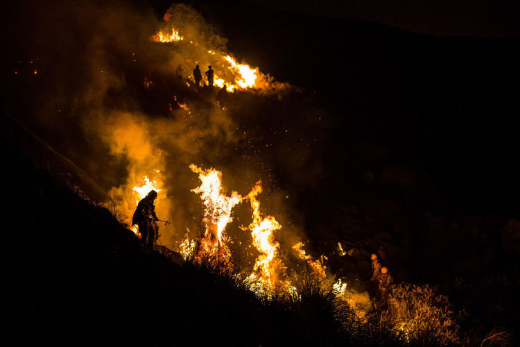 Firefighters working at night