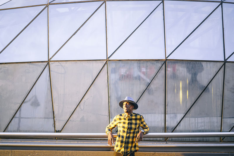 Rear view of man standing on metallic structure