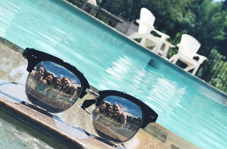 Swimming Pool Water Day Reflection Outdoors Close-up Real People Focus Sunglasses Swim Sky Feature
