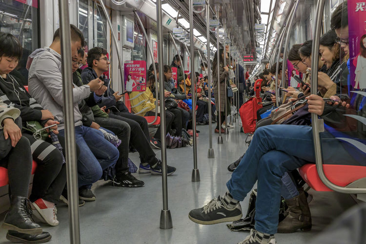 Chinese people looking into smartphones in Nanjing subway train Group Of People Large Group Of People Train Sitting Public Transportation Real People Rail Transportation Crowd Transportation Men Mode Of Transportation Train - Vehicle Women Travel Journey Passenger Adult Indoors  Lifestyles Waiting Subway Train China Nanjing Underground