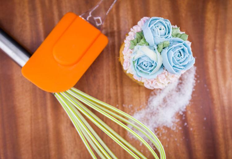 High angle view of cupcake on table