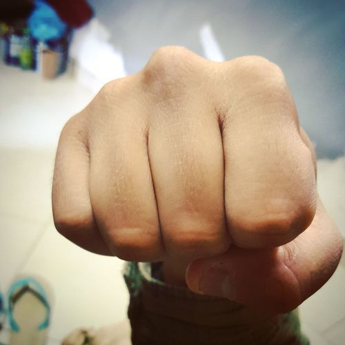 Close-up of clenching fist