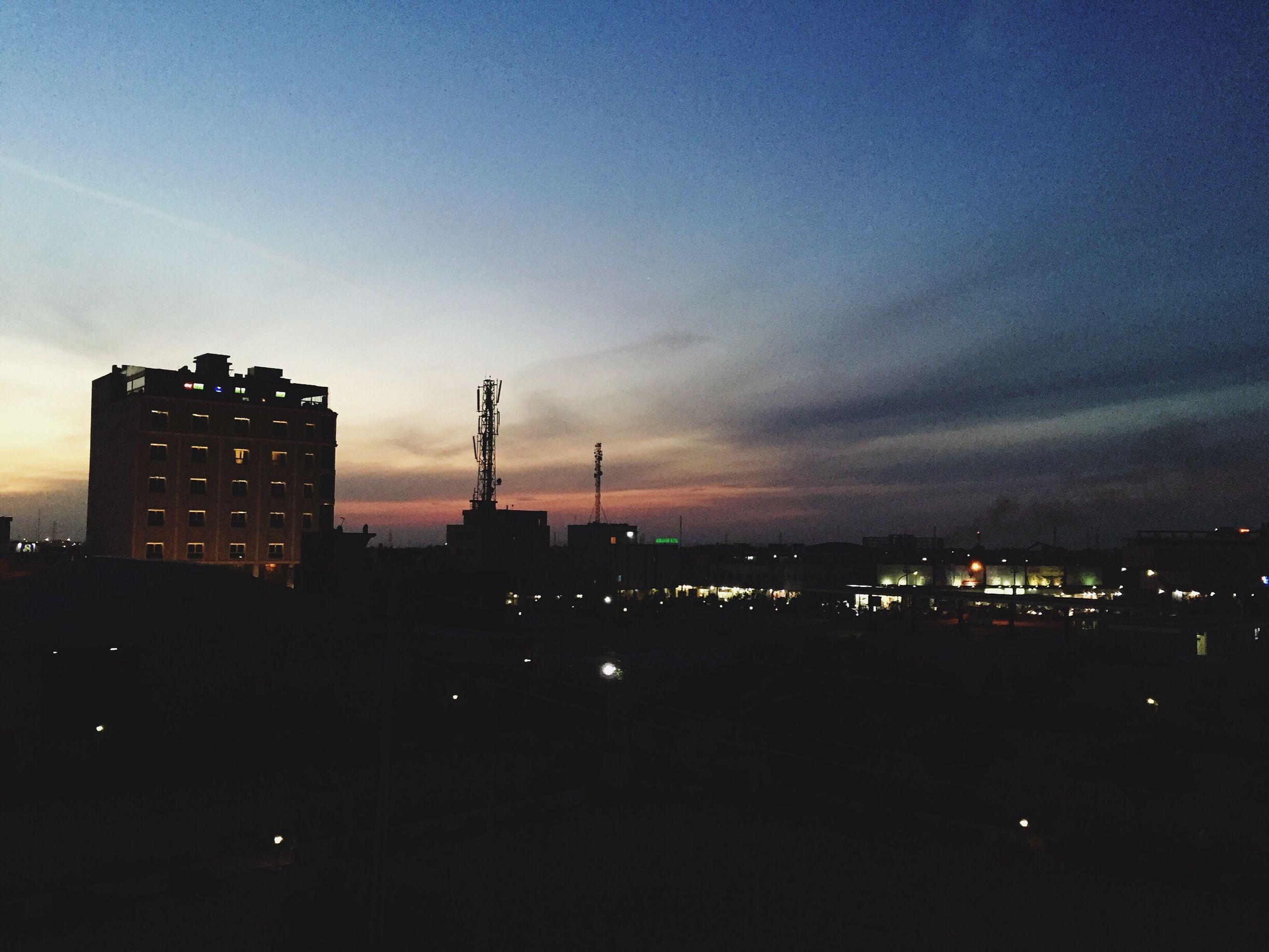 building exterior, architecture, built structure, silhouette, sky, city, illuminated, dusk, sunset, night, dark, cloud - sky, cityscape, building, copy space, outdoors, development, no people, residential building, cloud