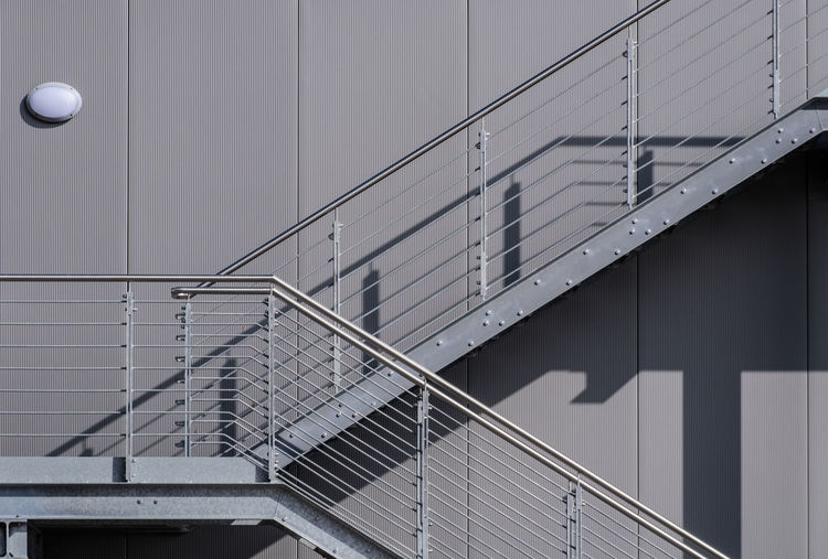 Architecture No People Day Built Structure Building Exterior Building Staircase Railing Steps And Staircases Wall - Building Feature Outdoors Metal Pattern Sunlight Shadow Lighting Equipment