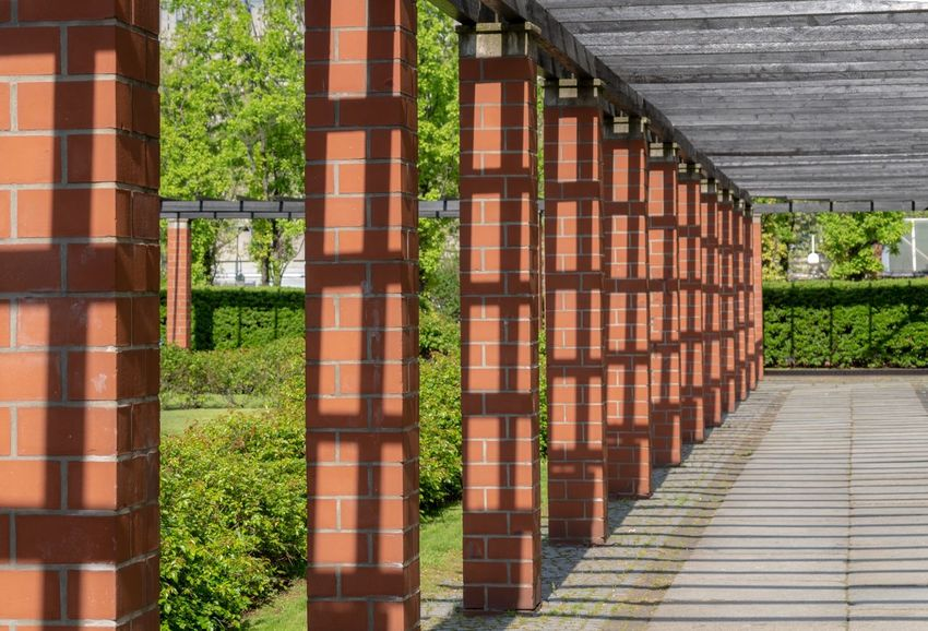 Park - Man Made Space Light And Shadow Charlottenburg  Colonnade Architecture Built Structure No People Plant Day Building Building Exterior Nature Tree Outdoors Wood - Material Brown Wall - Building Feature Pattern Roof Flooring Growth Brick Roof Tile In A Row