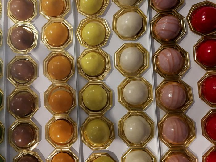Indoors  Repetition In A Row No People Full Frame Still Life Shape Backgrounds Directly Above Large Group Of Objects Side By Side Close-up Order Glass - Material Design Arrangement Gold Colored Food Container Food And Drink Temptation Steel Chocolate Yellow Color Texture