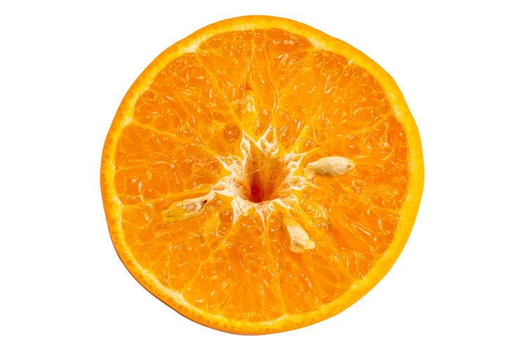 Close-up of orange slice against white background