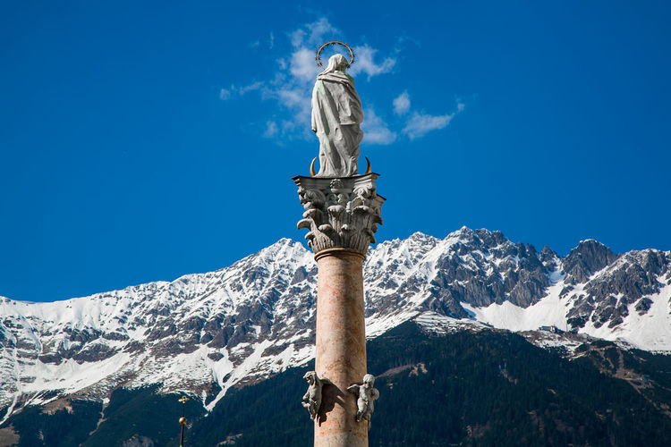 Virgin Mary of the Alps Art And Craft Beauty In Nature Blue Day Holy Low Angle View Mother Mountain Nature Outdoors Sculpture Sky Snow Spirituality Statue Sunlight Travel Destinations