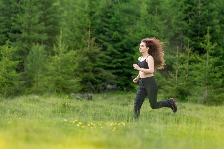 Woman running in field