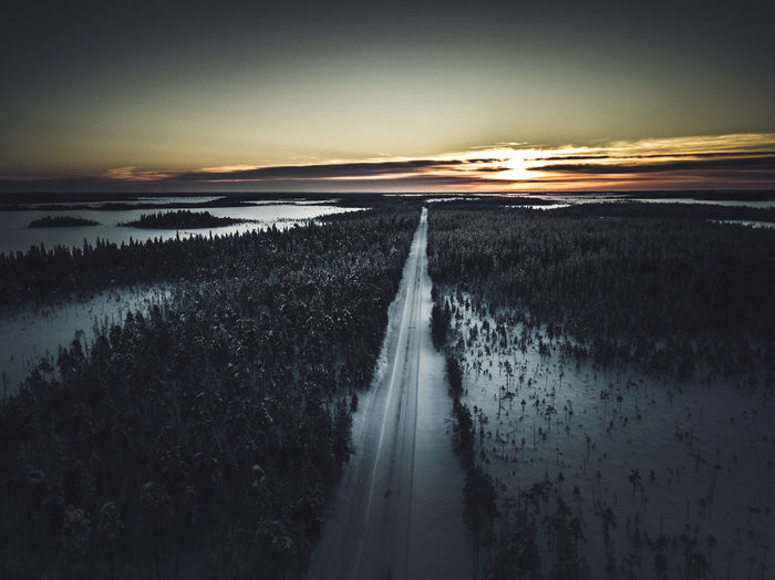 Smooth wilderness Sky Beauty In Nature Tranquility Tranquil Scene No People Nature Land Landscape Outdoors Cloud - Sky Road Lapland, Finland Wilderness Forest Winter Snow Sunrise View From Above High Angle View Tree Scenics Freshness Photography EyeEm Best Shots Check This Out
