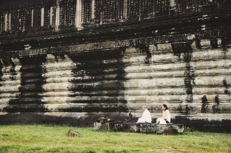 a moment of calmness amidst the chaos Meditation Neverstopexploring  Wanderlust Ancient Adventure Temple Exploring Wanderer Cambodia Amazing Tourist Inspirations Travel Adventurer Travelphotography Water Sitting Men Women Togetherness Grass Sky Visiting