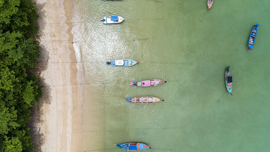 Directly above shot of nautical vessels moored at sea