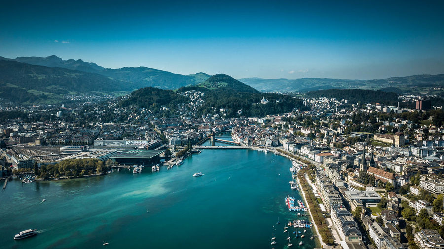 ABOVE LUZERN Water Architecture Built Structure Building Exterior City Nature Blue Sky No People Mountain Day High Angle View Sea Residential District Travel Destinations Aerial View Cityscape Building Scenics - Nature Outdoors Turquoise Colored Bay Suisse  Lucerne