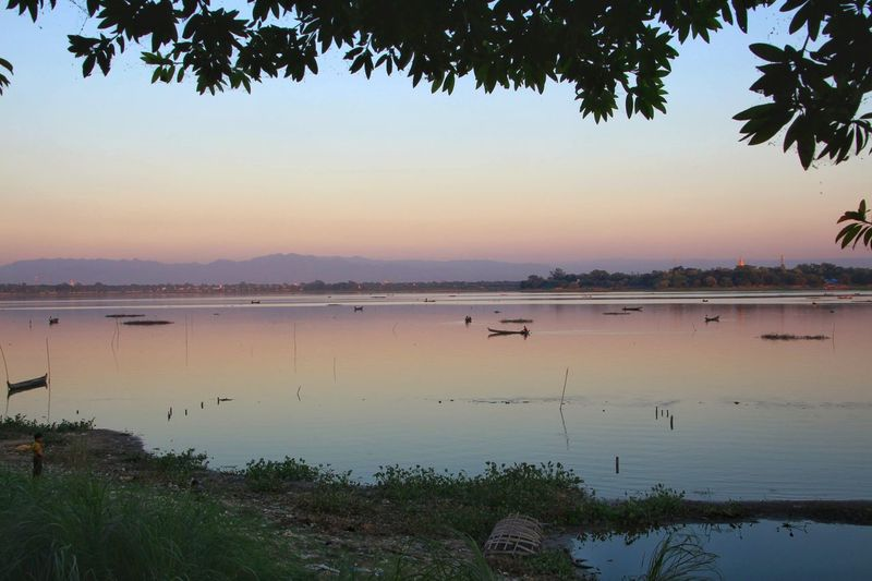 River at scenic in Mandalay, Myanmar ทะเลสาบตองตะมาน Calm Water Claming Coast Landscape Outdoors Sky Scene Scenic Scenery Nature Scenics - Nature View Travel Vacation Waterfront Famous Place Horizon Land Rural Scene Countryside Water Tree Sunset Clear Sky Beach Lake Blue Silhouette Floating On Water