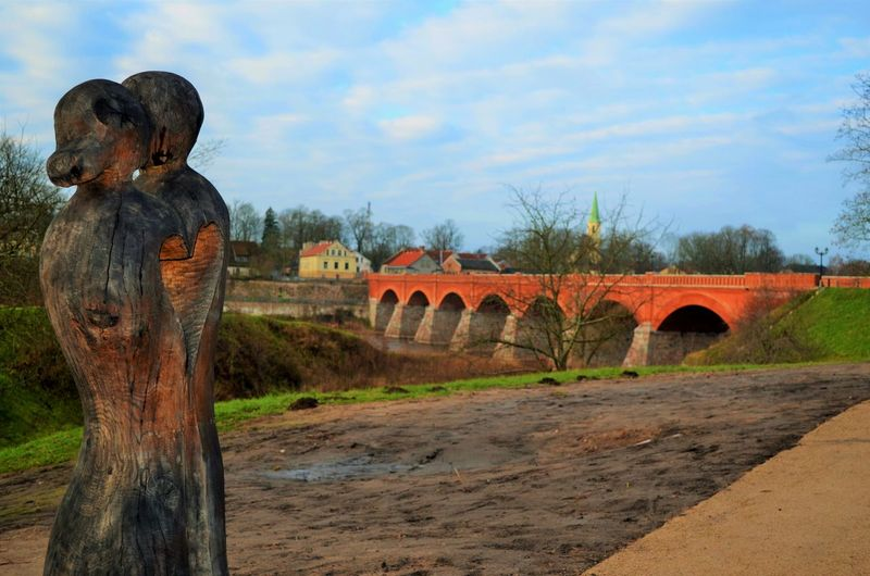 Lovers.. Art Baltic States Bridge Carved Wood Carving Carvings Couple Eastern Europe Europe Kuldiga Landscape Latvia Outdoors Skulpture Togetherness Wood Carving Wood Sculpture Wood Statue Woods Two Is Better Than One Pivotal Ideas Adventure Club The Culture Of The Holidays Home Is Where The Art Is Battle Of The Cities Long Goodbye