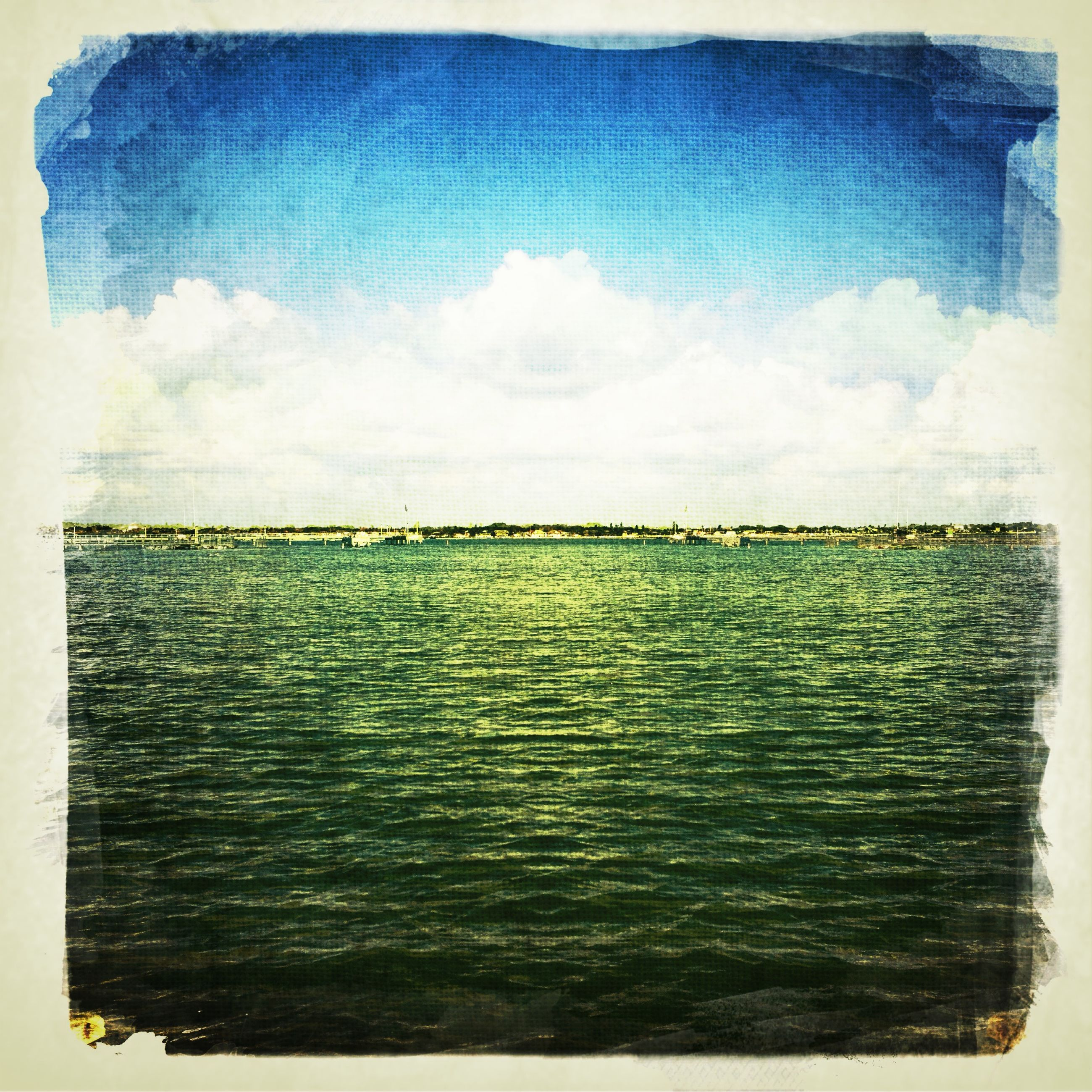 transfer print, auto post production filter, water, sea, sky, waterfront, beauty in nature, blue, scenics, tranquility, tranquil scene, nature, cloud - sky, horizon over water, idyllic, rippled, no people, outdoors, cloud, day