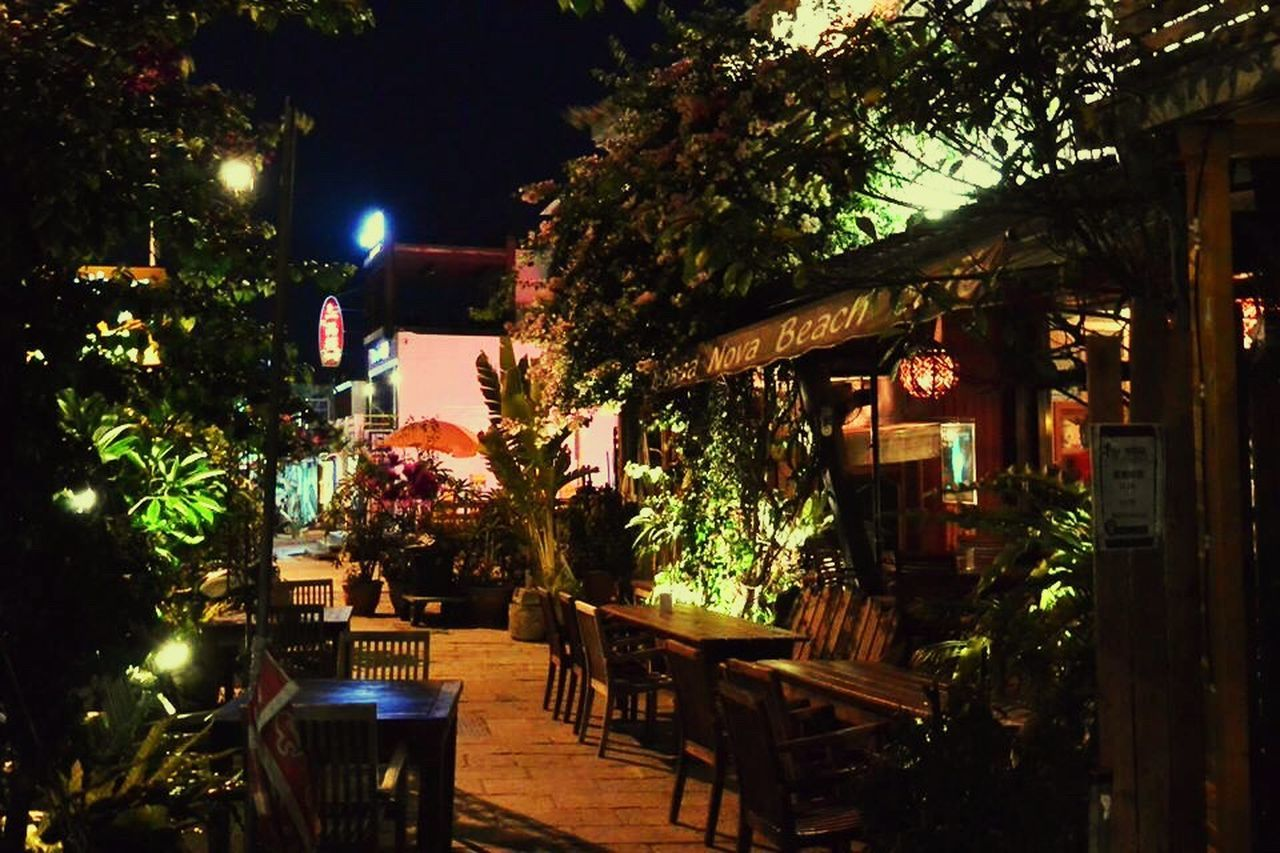 table, restaurant, night, outdoors, chair, cafe, tree, architecture, illuminated, no people, building exterior