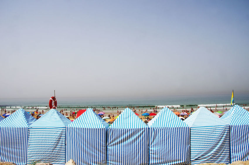 A portugal beach in Costa Caparica ,wind and sun shelter Portugal Beach Costa Caparica Beach Clear Sky Horizon Horizon Over Water Sea Sky Sun Shelter Tranquility Travel Travel Destinations Vacations Water