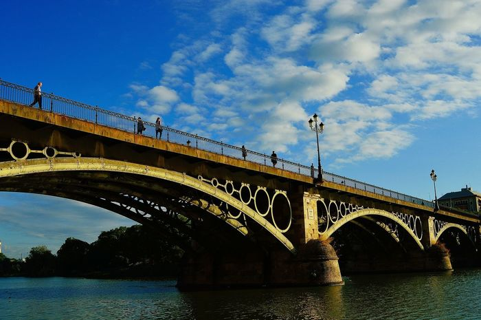 Triana bridge Bridge Triana Triana Bridge Bridge - Man Made Structure Architecture Connection Arch Built Structure Low Angle View Transportation Sky River Water Day Outdoors #urbanana: The Urban Playground