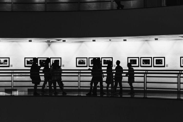 Men standing in corridor