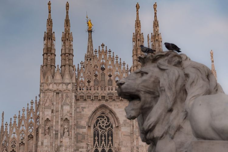 A view of the duomo of Milano Statue Architecture Sculpture Built Structure Outdoors Building Exterior No People Travel Destinations Low Angle View