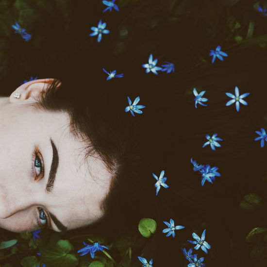 High angle view portrait of woman with flowers in hair